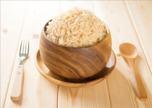 rice in wooden bowl on dining table.