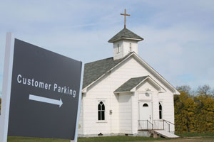 small-church-with-customer-parking-sign